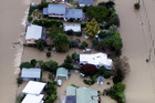 Aerial view of flooding through houses near Riwaka, Nelson. Photo / Tim Cuff