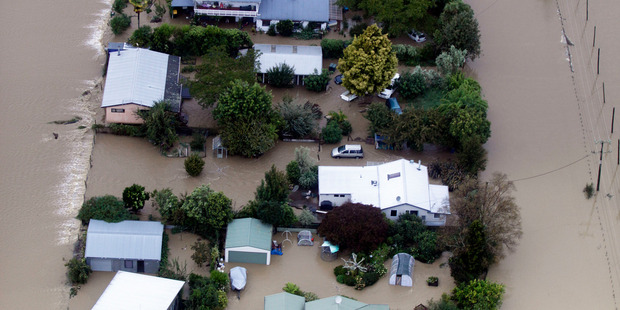 Loading Aerial view of flooding through houses near Riwaka, Nelson. Photo / Tim Cuff
