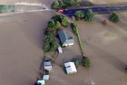 Aerial view of flooding on the  main road into Takaka, Nelson. Photo / Tim Cuff