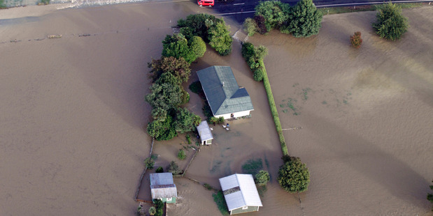 Loading Aerial view of flooding on the  main road into Takaka, Nelson. Photo / Tim Cuff