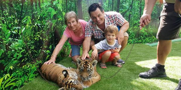 Loading Heather, Winston and Baxter Aldworth meet some tiger cubs at Dreamworld on the Gold Coast / Winston Aldworth