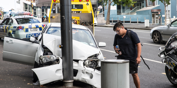 The drama unfolded about 11am when a white car turned left onto Queen St from the Symonds St end of Karangahape Rd. Photo / Michael Craig