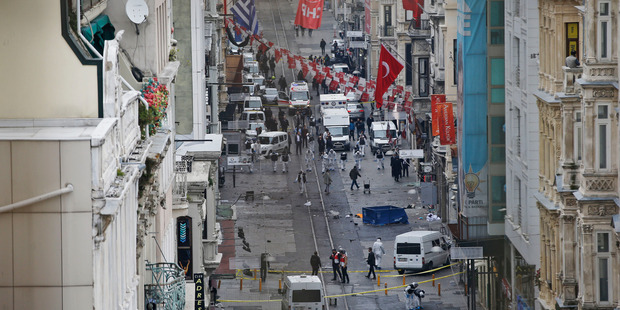 Emergency services at the scene of an explosion, on a street, in Istanbul, Turkey. Photo / AP
