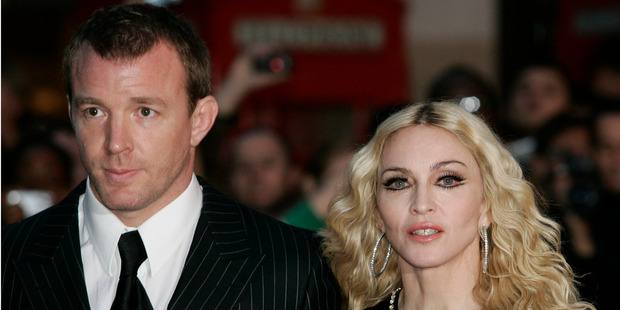 British director Guy Ritchie and Madonna have once again been asked by a judge to sort it out over their son's custody battle.