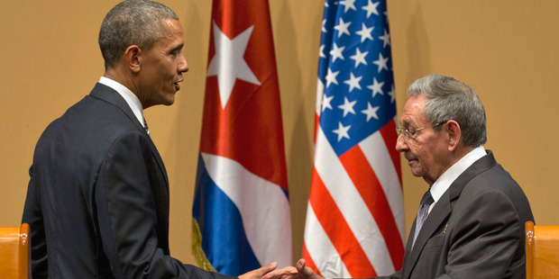 US President Barack Obama and Cuba's President Raul Castro shake hands after a joint statement in Havana, Cuba. Photo / AP