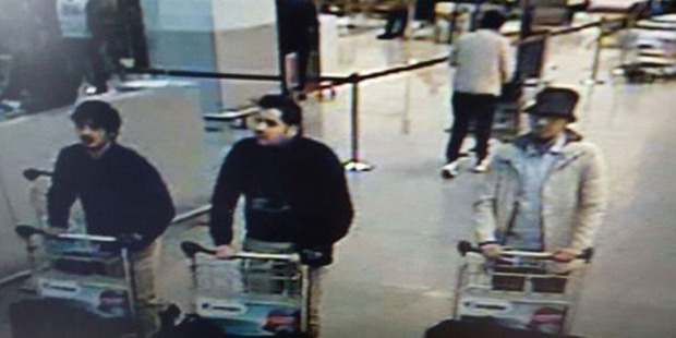 The three men who are suspected of taking part in the attacks at Belgium's Zaventem Airport. The man at right is still being sought by the police. Photo / AP