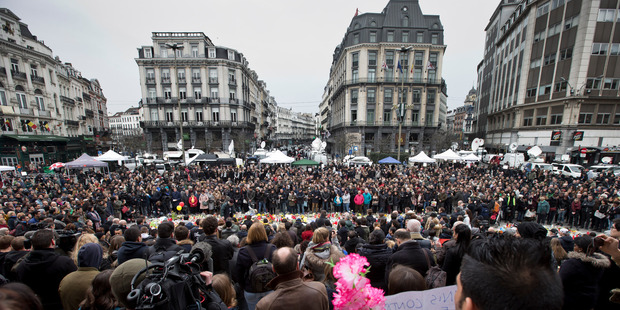 Loading People gathered to observe a minute of silence and mourn for the victims of the bombings at the Place de la Bourse in the center of Brussels, Belgium. Photo / AP