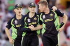 Australia's captain Steven Smith, centre, and Adam Zampa, left, congratulate bowler James Faulkner, right, after he took five wickets in their 21 run win over Pakistan. Photo / AP.
