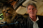 Peter Mayhew as Chewbacca and Harrison Ford as Han Solo in Star Wars: The Force Awakens.