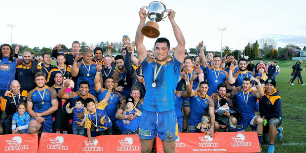 Tauranga Sports captain Carl Axtens holds aloft the Baywide Trophy after beating Te Puke Sports in last year's final.
