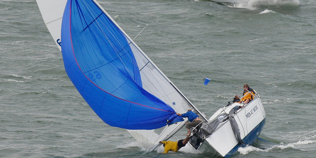 A crewman on the yacht Men At Work falls overboard during the Auckland Anniversary Day Regatta, on Auckland's Waitemata Harbour. Photo / Brett Phibbs