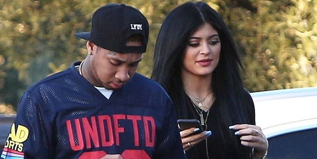 Tyga with girlfriend Kylie Jenner, has run into trouble over a photo snapped by the paparazzi.