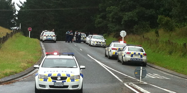 Police block access to Cinder Way, Hikurangi, where there has been an Armed Defenders Squad callout. PHOTO/KRISTIN EDGE