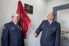 Chief fire officer Snow Buckton is all smiles as New Zealand Fire Service executive and national commander Paul Baxter unveils the official plaque marking the opening of the new Hikurangi fire station. Photo / Sue Shepherd