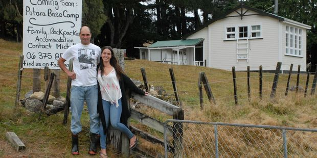 Quinn Tua-Davidson with partner Michelle Kucyniak who have set up Putara Base Camp at the old Putara Primary School. PHOTO/EMILY NORMAN