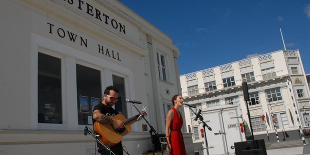 Jason Ireland and Wairarapa Times-Age reporter and songstress Emily Norman captivate the crowd at the Summers End Cushion Concert in the Masterton Town Square on Saturday. PHOTO/NATHAN CROMBIE