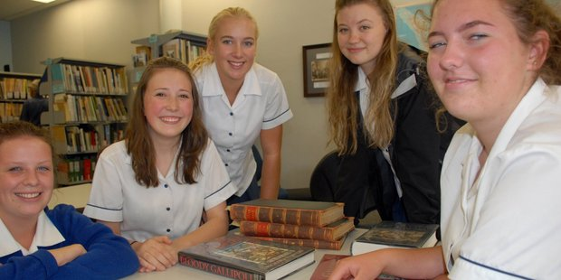 Wairarapa College pupils Megan King, left, Ruby Govan Gaffney, Millie Moser, Erin Charnock, and Lola Coulthard-Miller at Masterton's Wairarapa Archive. PHOTO/NATHAN CROMBIE