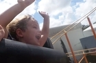 Baxter Aldworth rides the Roadrunner Rollecoaster at Movie World on the Gold Coast.