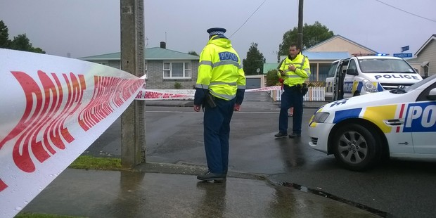 Loading Police on the scene of the shooting in Whanganui. Photo / Supplied
