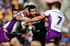 Ben Matulino of the Warriors fends against Cooper Cronk of the Storm during the round three NRL match between the New Zealand Warriors and the Melbourne Storm. Photo / Getty Images