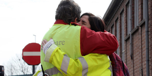 Loading Airport staff comfort each other as passengers are evacuated from Zaventem Bruxelles International Airport. Photo / Getty Images