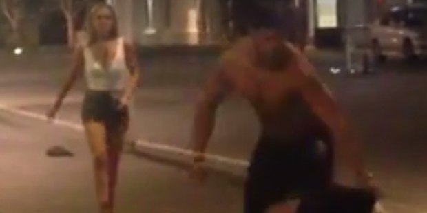 A young woman was knocked off her feet during a downtown brawl among drunken youths in the CBD.