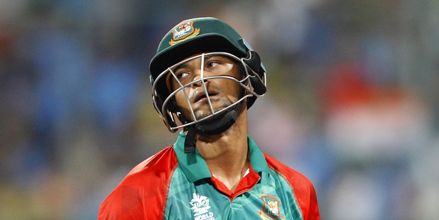 Loading Bangladesh's Shakib Al Hasan reacts as he leaves the ground after losing his wicket . Photo / AP
