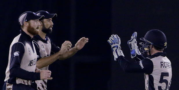 New Zealand players celebrate dismissal of Pakistan's Khalid Latif. Photo / AP