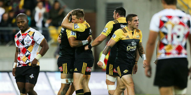 The Hurricanes celebrate a try against the Kings. Photo / Getty