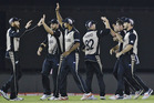 New Zealand players celebrate dismissal of Pakistan's Khalid Latif. photo / AP