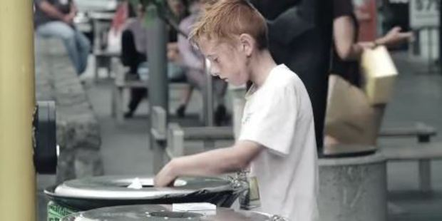 Loading In the first video released on the NZ Police Recruitment Facebook page, a young boy is shown eating out of a rubbish bin on a busy city street. Photo / NZ Police