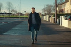Conor McGregor is pictured walking down the street in his native Dublin in his new Budweister advert. Photo / YouTube