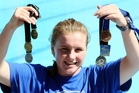 DRIVEN: Kate Allen with her spoils from the division two national swimming championship in Invercargill early this month. PHOTO/Paul Taylor