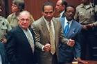 OJ Simpson is flanked by defence team F. Lee Bailey. Photo / AP