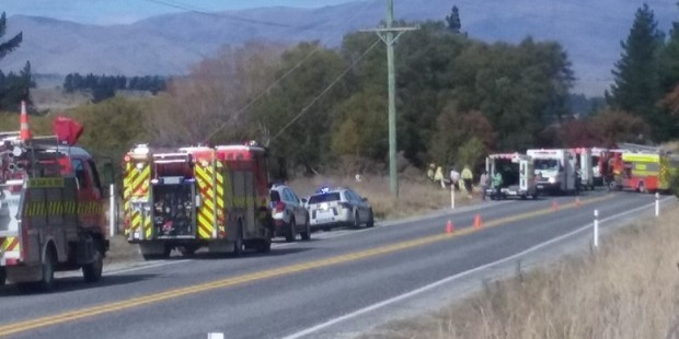 Loading Emergency services at the scene near Luggate this afternoon. Photo / Otago Daily Times