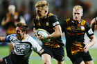 Damian McKenzie runs in a try against the Force tonight. Photo / Getty