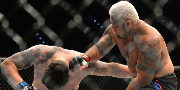 Mark Hunt delivers the knock out punch against Frank Mir during their UFC Heavyweight Bout at UFC Brisbane. Photo / Getty
