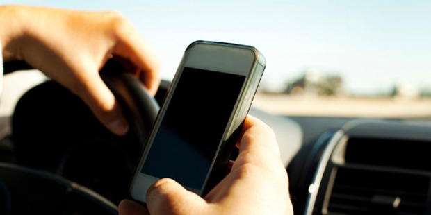 Of the 2000 Kiwis surveyed, a third said they thought using mobile phones while driving was safe. Photo / iStock