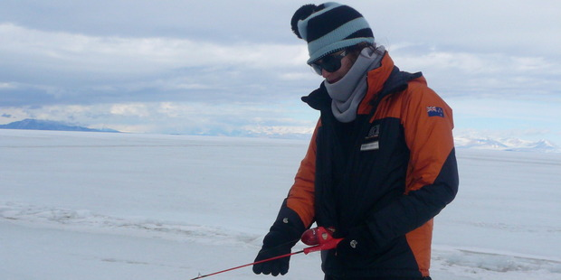 Science writer Dr Rebecca Priestley ice fishing on sea ice next to Ross Island,in  2011. Photo / Supplied