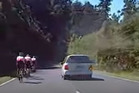 In the video, a voice can be heard yelling abuse at the cyclists. Photo / YouTube