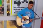The young man identified only as Tyrone performing a stirring rendition of the Charlie Puth song on an acoustic guitar. Photo: Sharik Hussein/Facebook