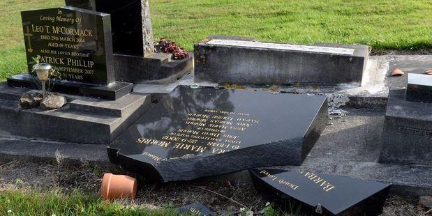 Broken headstones in the cemetery. Photo / Linda Robertson