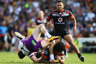 James Gavet of the Warriors tackles Cameron Munster of the Melbourne Storm. Photo / Getty