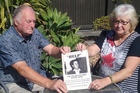 Phil Woods and Diane Turner with the poster family and friends put up around the region after their brother Richard mysteriously disappeared exactly 20 years ago today.  Photo / Roger Moroney