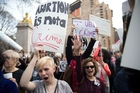 Protesters came out in force in New York this week to condemn Donald Trump's stance on women and abortion law. Photo / AP