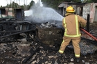 Kaikohe firefighter Tracey Hadwin at yesterday's house fire on Omapere Rd. Photo / Peter de Graaf