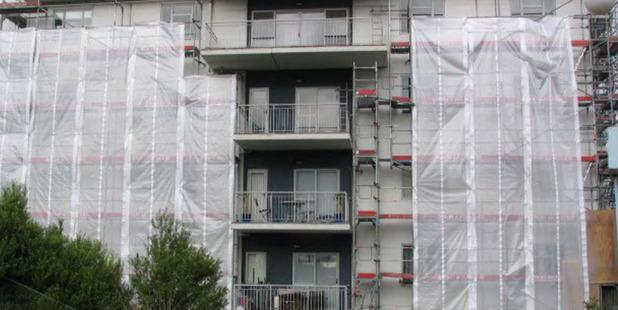 Loading The Landings apartment complex, undergoing repairs.