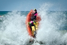 An IRB flies through the surf in action from last year's BP Surf Rescue New Zealand Championships held at Papamoa.