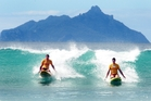 Brothers Ben and Adam McKernan kneeboarding at Ruakaka Beach on the last day of patrols at Northland's surf beaches yesterday. Photo / Tania Whyte