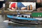 The image of drowned 3-year-old Aylan Kurdi, seen here in a graffiti work in Frankfurt, Germany, sent shockwaves around the world. Picture / AP